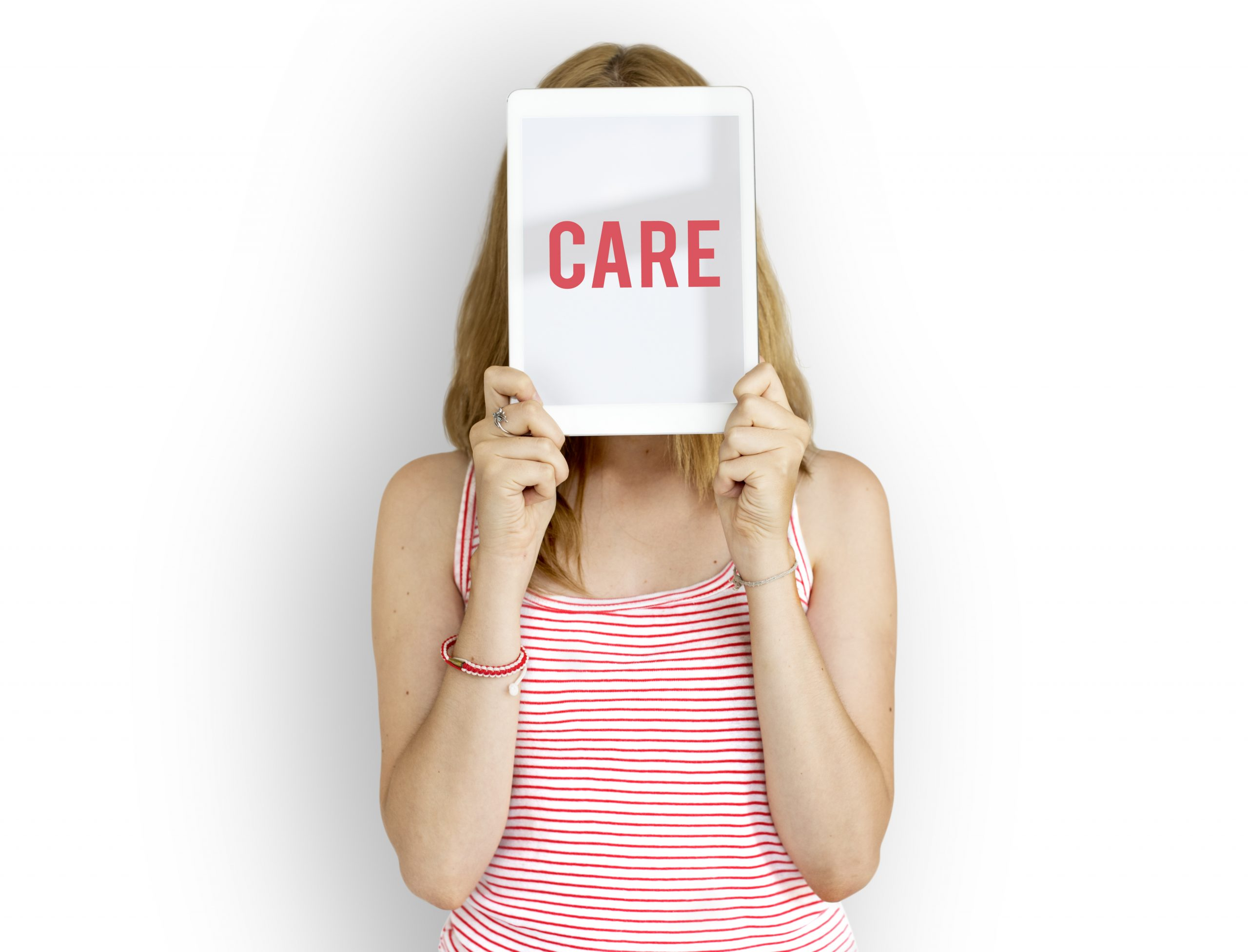 woman-holding-word-care
