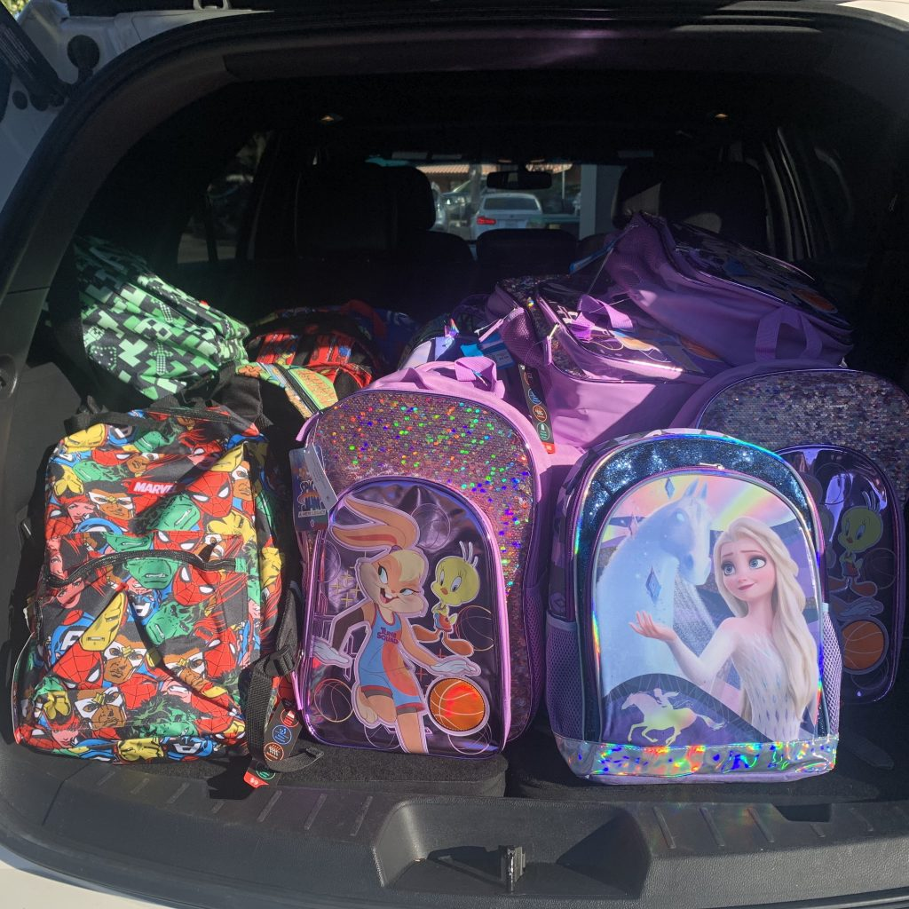 backpacks in the trunk fo a car