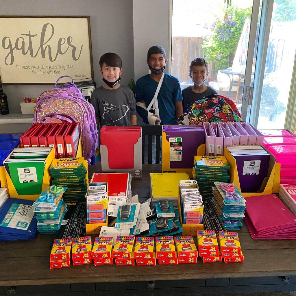 children with school supplies